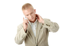 Smiling Businessman Using Phone. Yong Businessman Using wireless Phone royalty free stock images