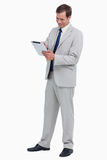 Smiling businessman using tablet computer. Against a white background Royalty Free Stock Image
