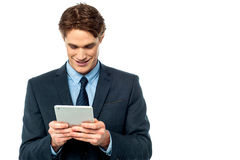 Smiling businessman using a tablet pc Royalty Free Stock Photo