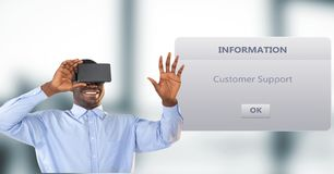 Smiling businessman using VR Glasses by dialog box in background. Digital composite of Smiling businessman using VR Glasses by dialog box in background Royalty Free Stock Photo