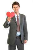 Smiling businessman with Valentin heart Stock Image