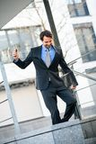 Smiling businessman walking down stairs Stock Images