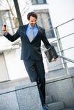 Smiling businessman walking down stairs Royalty Free Stock Photo