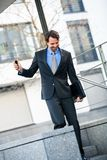 Smiling businessman walking down stairs Stock Photography
