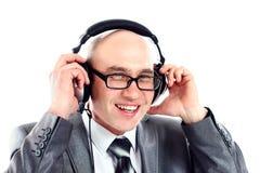 Smiling businessman wearing headphones looking to camera stock photo