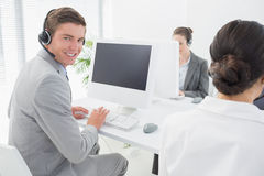 Smiling businessman wearing headset Royalty Free Stock Images