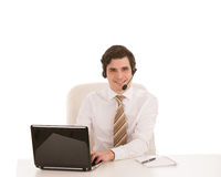 Smiling businessman wearing a headset Royalty Free Stock Photos