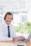 Smiling businessman wearing a headset Stock Image