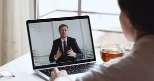 Smiling businessman wearing suit video conferencing interviewing job applicant