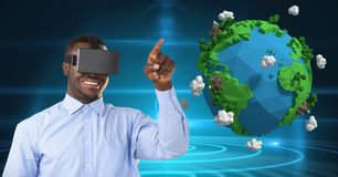 Smiling businessman wearing VR glasses by low poly earth. Digital composite of Smiling businessman wearing VR glasses by low poly earth Stock Photos