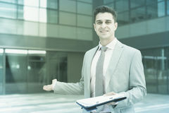 Smiling businessman welcoming partners royalty free stock photo