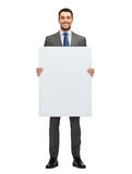 Smiling businessman with white blank board Stock Images