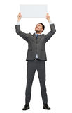Smiling businessman with white blank board Royalty Free Stock Image