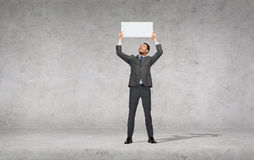 Smiling businessman with white blank board Royalty Free Stock Photography
