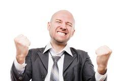 Smiling businessman winner gesturing raised hands fist celebrating victory achievement Stock Photo