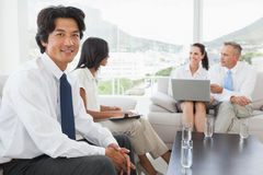 Smiling businessman with work colleagues Royalty Free Stock Images
