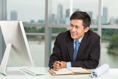 Smiling businessman at work Stock Photo