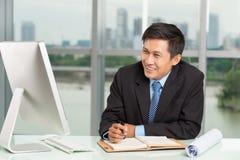Smiling businessman at work Stock Photo