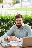Smiling Businessman Working in Cafe Royalty Free Stock Photo