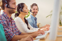 Smiling businessman working in a call centre Stock Photos
