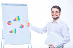 Smiling businessman working with charts Royalty Free Stock Images