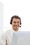 Smiling businessman working at a computer Stock Photos