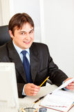 Smiling businessman working with documents Stock Photography