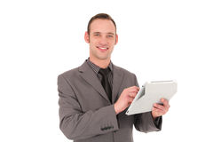 Businessman working on his tablet Stock Image