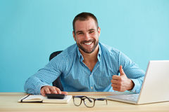 Smiling businessman working in office Stock Images