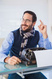 Smiling businessman working on typewriter Stock Image