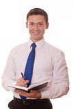 Smiling businessman writes information Stock Photo