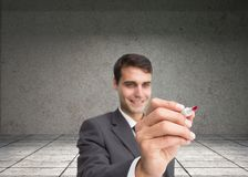 Smiling businessman writing something with marker Royalty Free Stock Photo