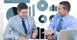 Smiling businessmen discussing against graphs royalty free stock image