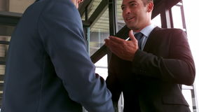Smiling businessmen having a handshake. In the office stock video