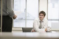 Smiling Businessmen Listening To Male Colleague Stock Photography