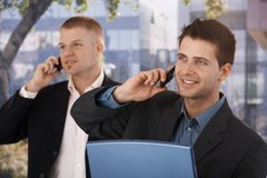 Smiling businessmen making phone call Stock Photos