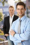 Smiling businessmen outside of office Royalty Free Stock Image