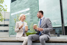 Smiling businessmen with paper cups outdoors Royalty Free Stock Photos