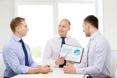 Smiling businessmen with papers in office Royalty Free Stock Photo