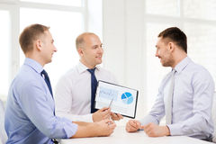 Smiling businessmen with papers in office Royalty Free Stock Images