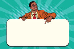 Smiling businessmen presenting empty board. Pop art retro vector. African American people Royalty Free Stock Photo