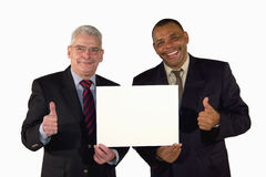 Smiling businessmen presenting a picture board royalty free stock photography