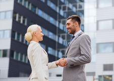 Smiling businessmen standing over office building Royalty Free Stock Photos