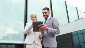 Smiling businessmen with tablet pc outdoors Royalty Free Stock Photos