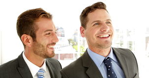 Smiling businessmen talking together. In his office stock video footage