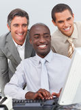 Smiling businessmen working at a computer Stock Photos