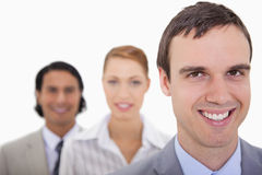 Smiling businesspartner lined up Royalty Free Stock Photography