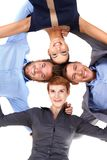 Smiling businesspeople embracing. Smiling young businesspeople standing embracing, view from below stock photos