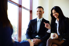 Smiling businesspeople having coffee break Stock Photo