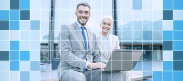 Smiling businesspeople with laptop outdoors Stock Photos